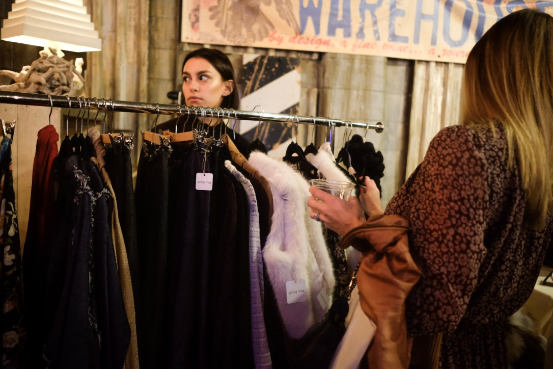 Shopping a rack of clothes at Local Coterie